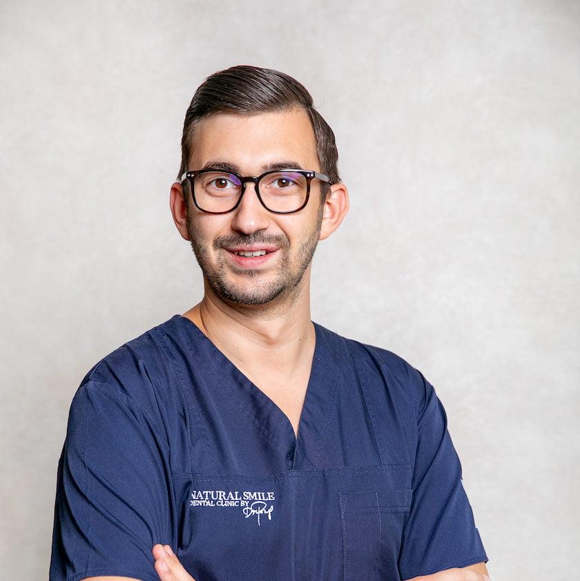 DR. ANDREI PETRUŢ